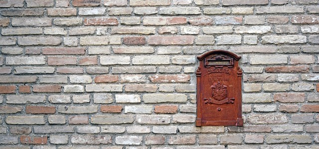 Letter box in brick wall.